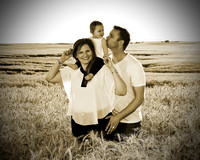 family in wheat sepia